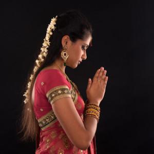 Woman in sari praying