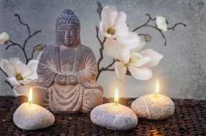 Budda statue with three candles.