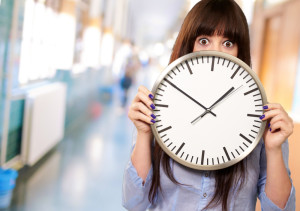 overwhelmed woman holding clock