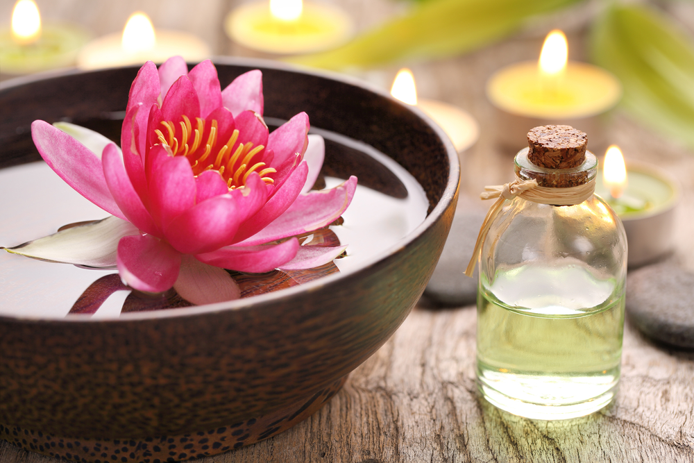 floating lotus flower and essential oil