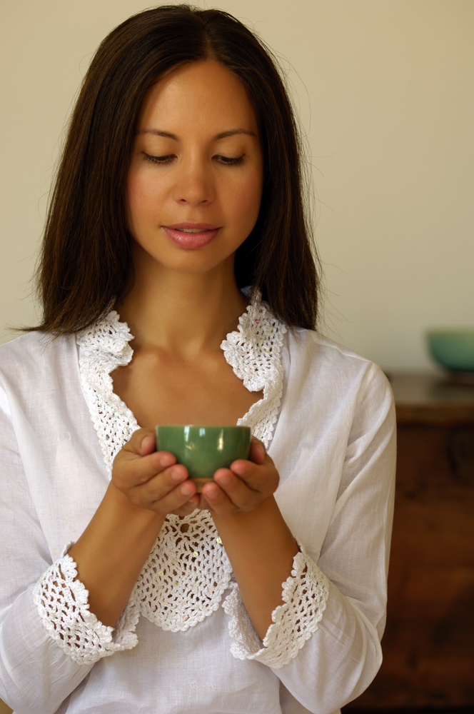 peaceful woman holding cup of tea