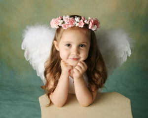 little girl dressed like an angel