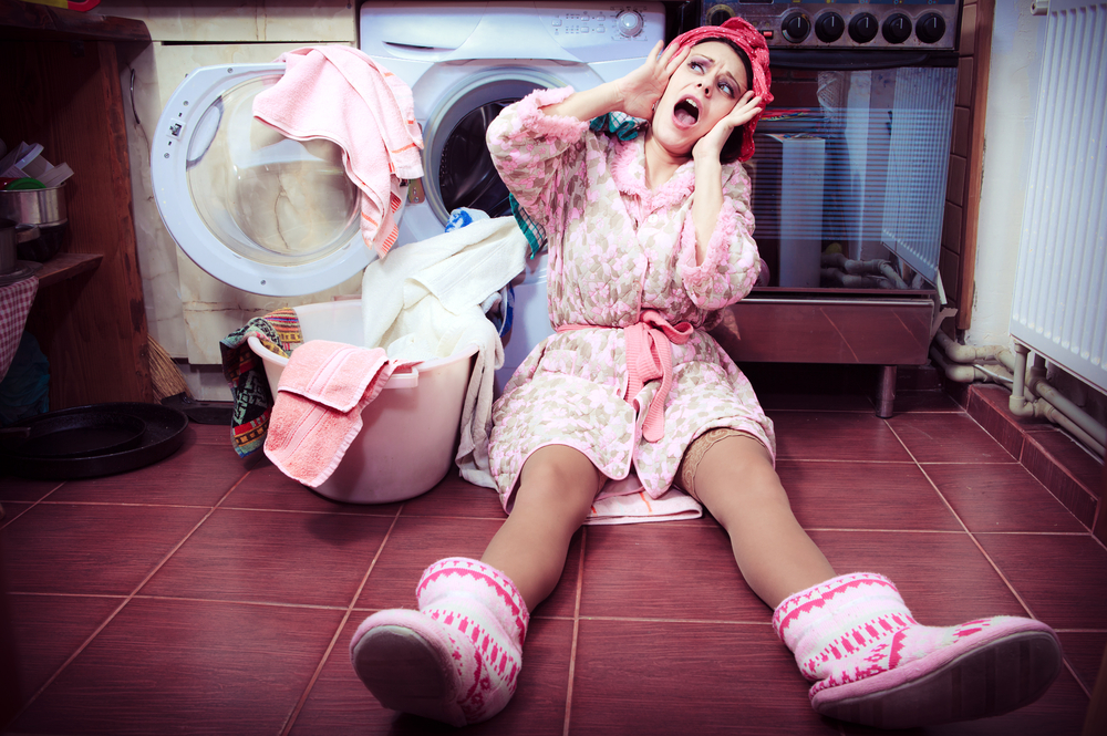 Woman overwhelmed with chores