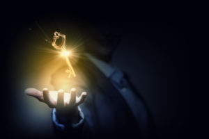 The second key - manifestation and truth. A golden key hovering above a man's hand