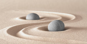 two stones with raked sand. Zen, harmony, peacefulness, meditation