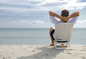 man on beach envisioning the life he wants to live